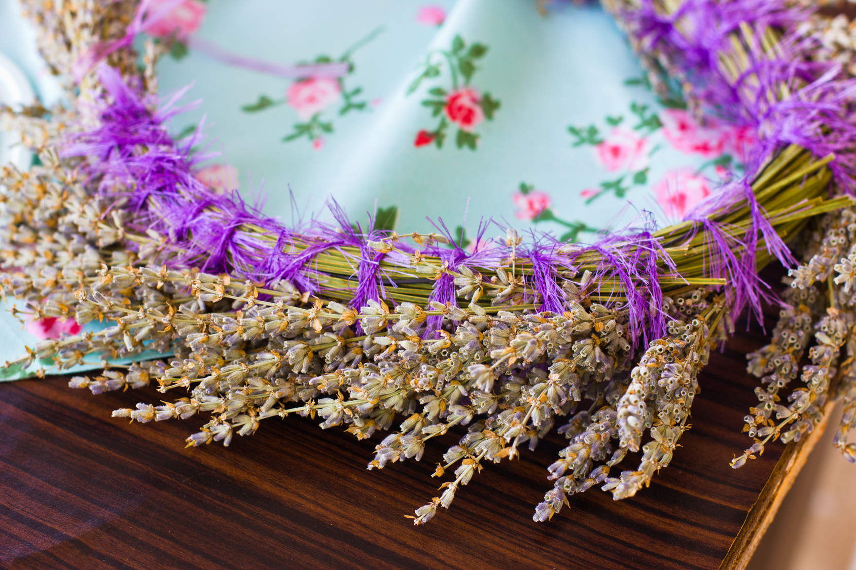 Hair ornament. A delicate wreath of dry lavender on blue tablecloth
